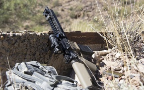 Picture grass, stones, machine, bag, sleeve, assault rifle