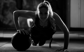 Picture woman, crossfit, workout, ball training, shadows