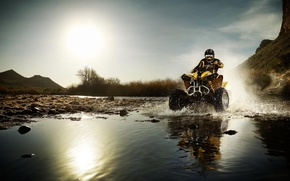 Picture the sun, squirt, stones, puddle, ATV
