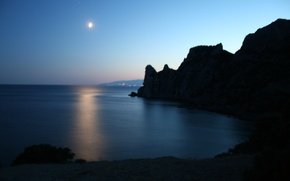 Picture sea, rocks, the moon