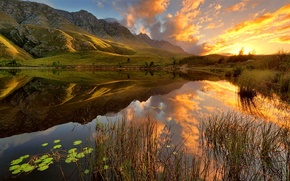 Picture the sky, grass, water, the sun, clouds, lake, Mountains