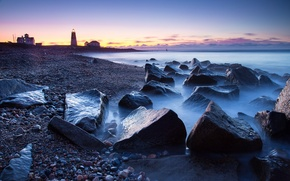 Picture sea, the sky, stones, lighthouse, the evening