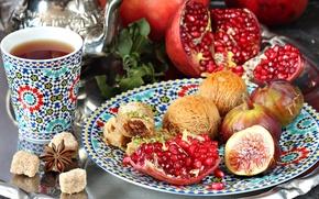 Picture tea, sugar, garnet, spices, figs