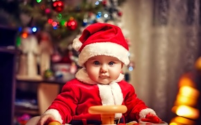 Picture look, holiday, child, baby, happy, lights, small suit of Santa Claus, tree, new year, Christmas