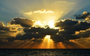 Picture the sun, clouds, rays, the ocean