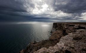 Picture sea, the sun, clouds, rocks