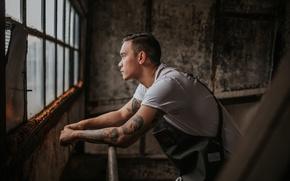 Picture man, window, tattoos