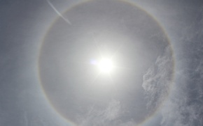 Picture the sun, clouds, halo