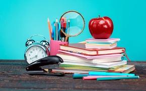 Wallpaper table, books, Apple, pencils, alarm clock, magnifier, notebook, scissors, stapler