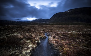 Picture field, mountains, stream, storm, gray clouds