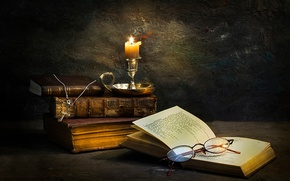 Picture books, candle, glasses, cross