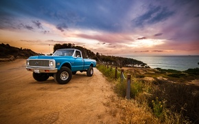 Picture road, sea, the sky, clouds, sunset, the fence, Chevrolet, wheel, front, side, 1972