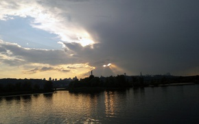 Picture the Dnieper river, through the clouds, the light of the sun