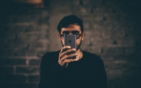 Picture face, room, wall, iPhone, hands, glasses, male