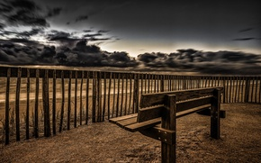 Picture sea, the sky, the fence, bench