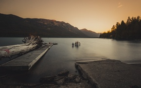 Wallpaper lake, mountains, driftwood, pierce, the sky, people, sunset