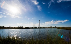 Picture grass, water, the sun, lake, glare, view, rocket, day, spaceport