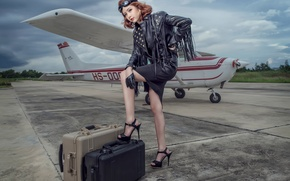 Picture girl, legs, the plane, suitcases
