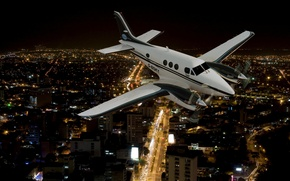 Picture night, the city, lights, the airplane