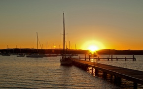Picture the sky, the sun, sunset, mountains, lake, yachts, pier, pierce