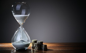 Picture glass, coins, hourglass