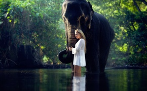 Picture girl, elephant, in the water, Serene