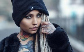 Picture look, girl, face, style, model, makeup, piercing, tattoo, dreadlocks, cap