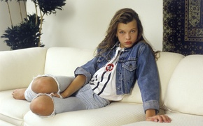 Picture look, girl, flowers, sofa, wall, movie, the film, carpet, model, jeans, earrings, Hollywood, actress, Milla …