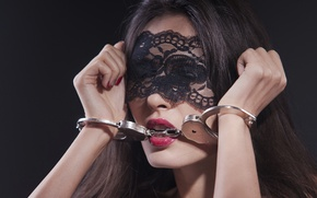Picture woman, makeup, metal handcuffs