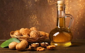 Picture oil, bottle, walnuts