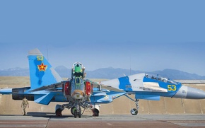 Picture fighters, Parking, the airfield, taxiing, su-27UB, the MiG-27, air force Kazakhstan