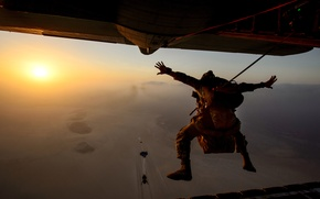 Picture the sky, the sun, the plane, skydivers