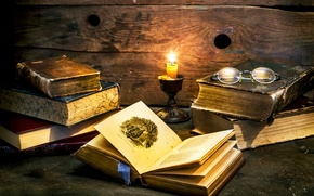 Picture books, candle, glasses, By candle light
