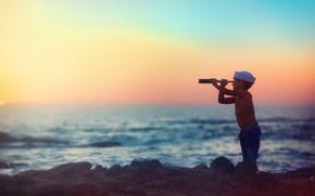 Picture sea, sunset, boy, spyglass