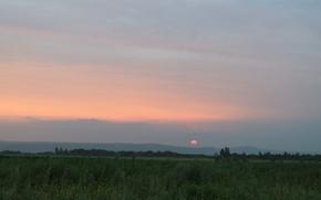 Picture sunset, hills, the Amur region