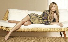 Picture actress, Jennifer Aniston, lying on the sofa, barefoot