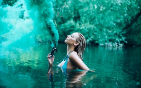 Picture girl, river, smoke, in the water