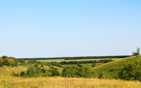 Picture greens, summer, hills, the vast expanses of Russia
