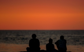 Picture sea, sunset, people, silhouettes