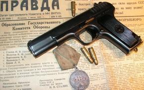 Picture gun, medal, newspaper, cartridges