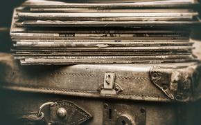Wallpaper vinyl, suitcase, records
