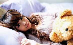 Picture girl, smile, toy, pillow, bear, bed, Asian, the sun's rays