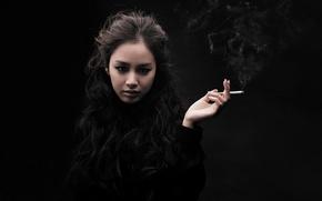 Picture hand, Asian, cigarette, black background
