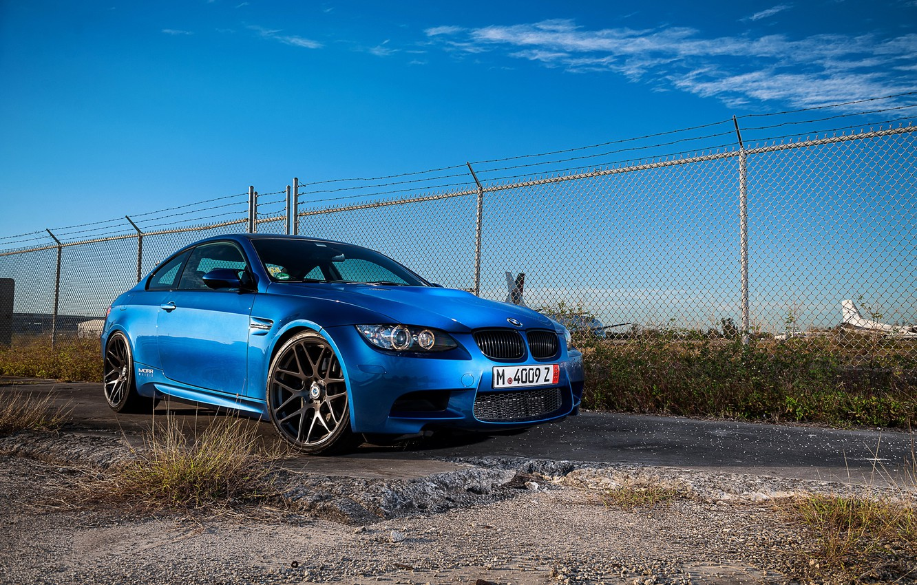 Photo wallpaper the sky, clouds, blue, bmw, BMW, the fence, front view, blue, e92, daylight