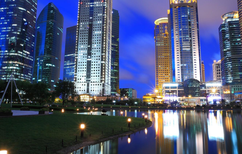 Photo wallpaper grass, light, trees, city, the city, lights, building, lake, grass, trees, night, lake, night, buildings, …