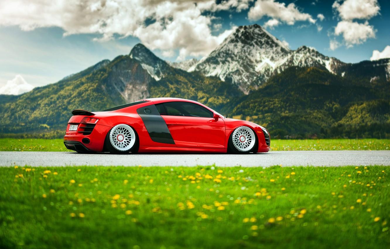 Photo wallpaper grass, flowers, mountains, Audi, red, landing, suspension, stancenation