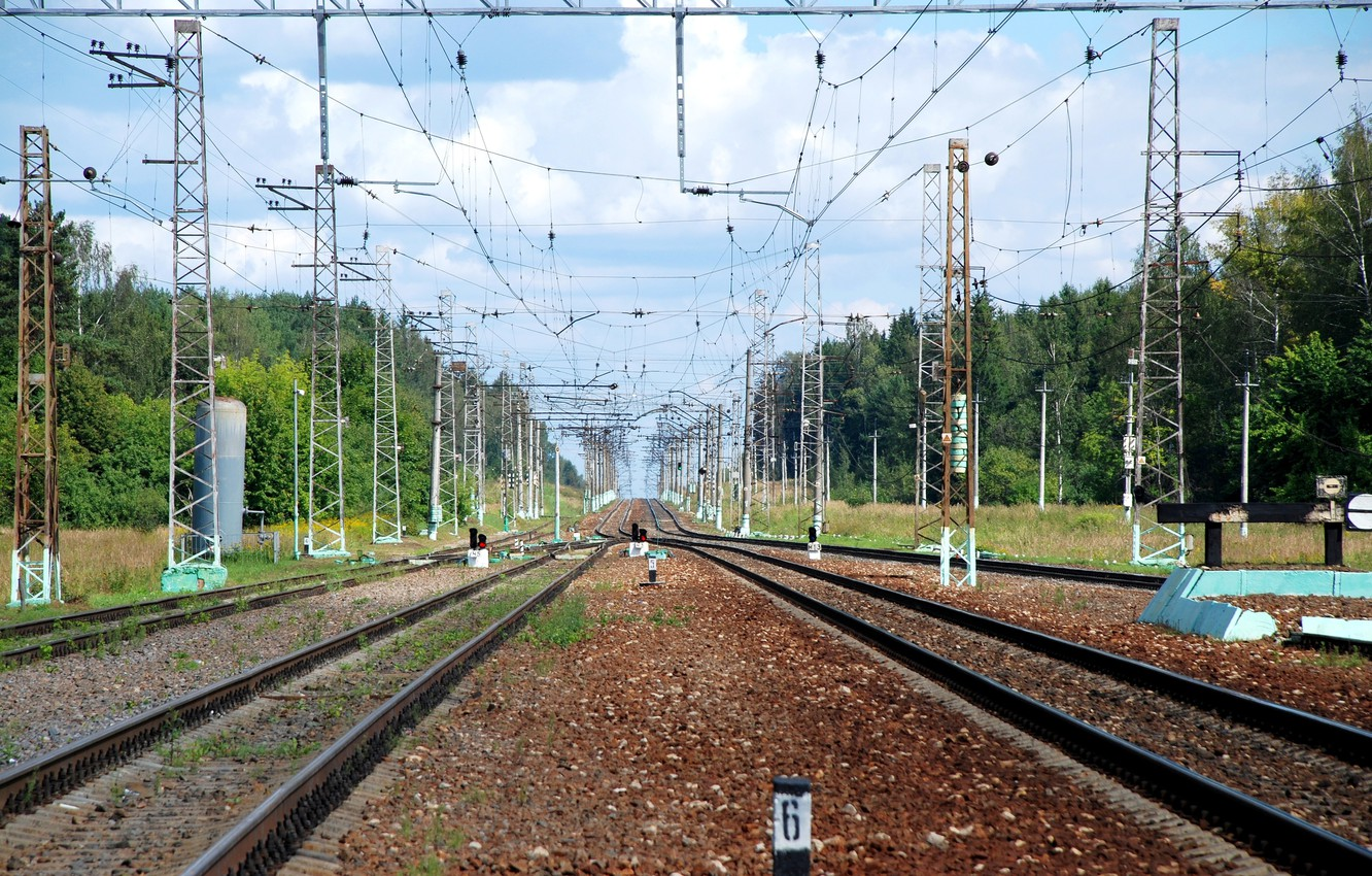 Photo wallpaper rails, support, sleepers, contact network, railway stretches into the distance