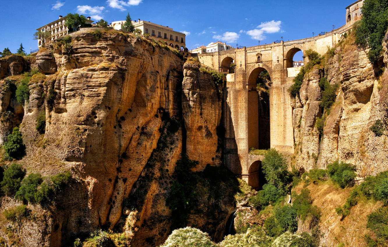 Photo wallpaper the sky, mountains, bridge, rocks, home, arch, gorge, Spain, Spain, aqueduct, Andalusia, Ronda