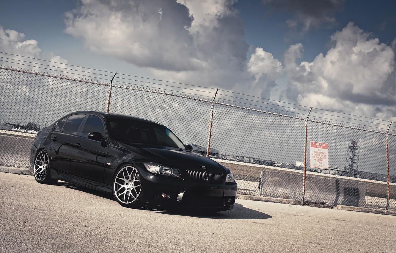 Photo wallpaper the sky, clouds, the fence, BMW, BMW, black, black, 335i, the front part, concrete blocks, …