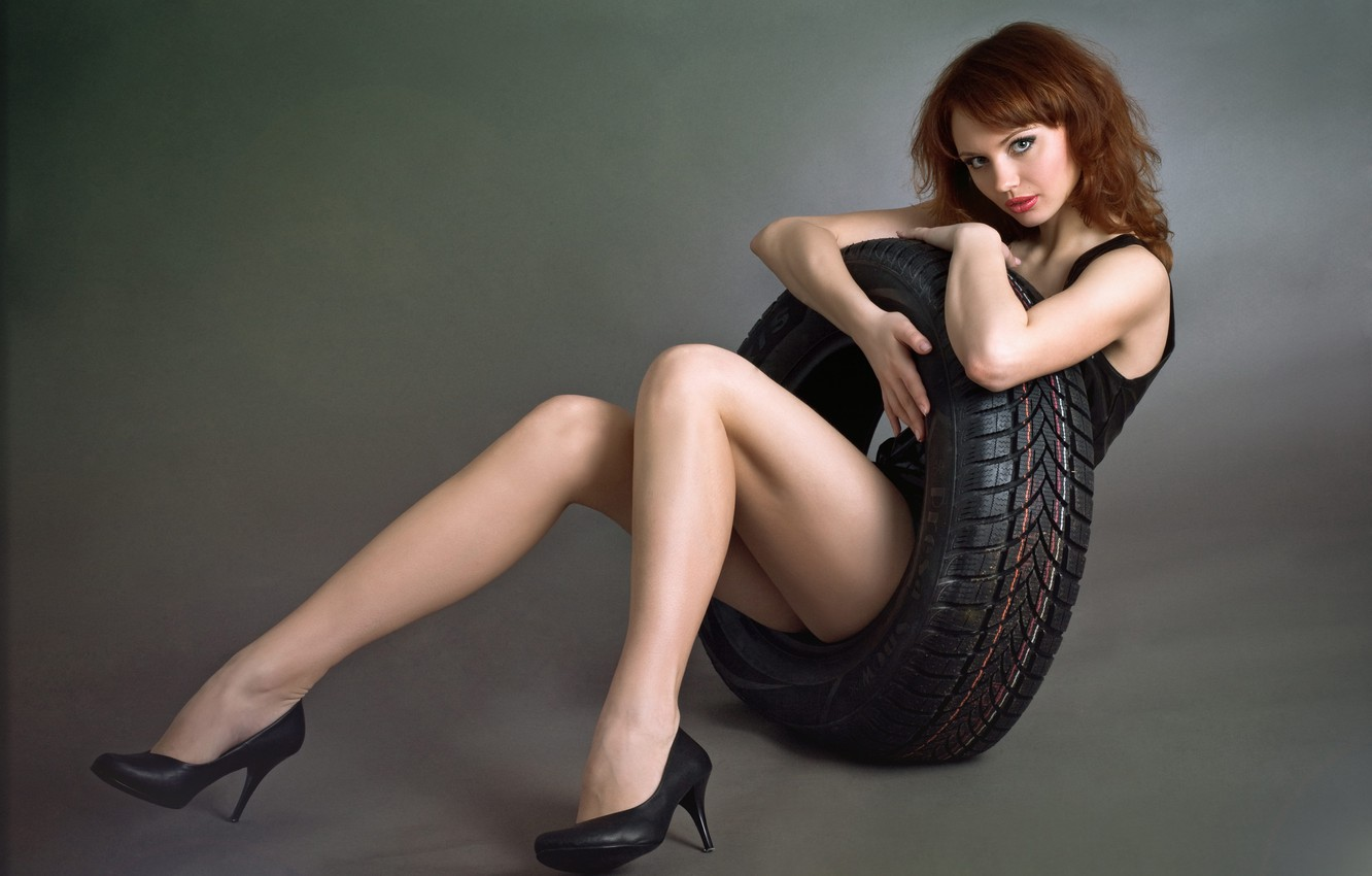 Photo wallpaper look, girl, smile, mood, dress, black, beautiful, redhead, car, tire, wheels., embraced, tyre